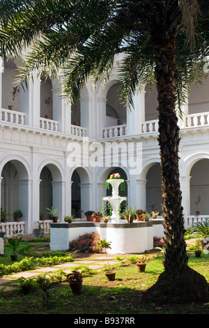 The Basilica of Bom Jesus enclosed patio with fountain under palm. - Stock Photo