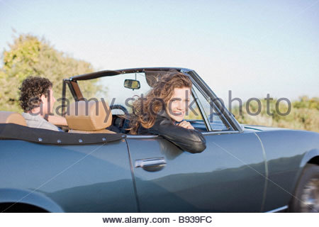Couple driving in convertible - Stock Photo