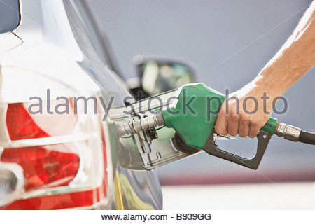 Man pumping gas - Stock Photo