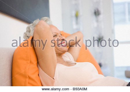 Senior woman relaxing in bed - Stock Photo