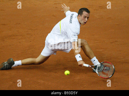 Russia s Nikolai Davydenko playing against Philipp Kohlschreiber photo in the Russia Germany Davis Cup semi finals - Stock Photo