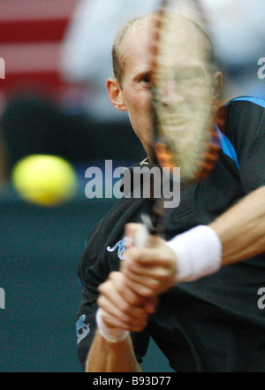 Russia s Nikolai Davydenko photo playing against Philipp Kohlschreiber in the Russia Germany Davis Cup semi finals - Stock Photo
