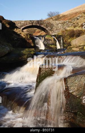 Packhorse Bridge and Panniers Pool at Three Shires Head, Peak District - Stock Photo