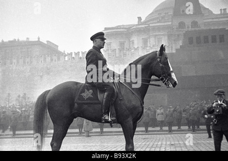 USSR Commissar of Defense Kliment Voroshilov reviewing troops at a parade in Red Square - Stock Photo