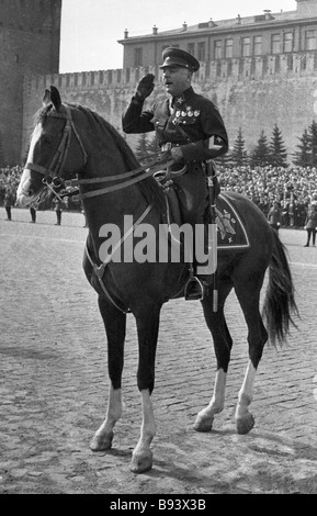 The USSR People s Commissar of Defense Kliment Voroshilov reviewing troops on Red Square in Moscow - Stock Photo