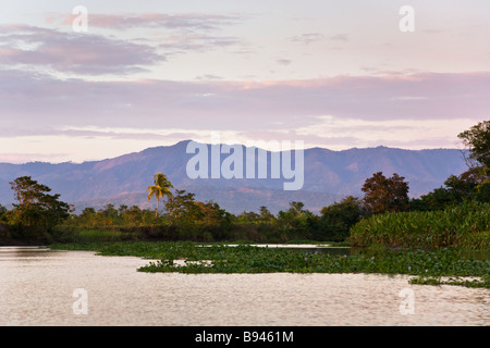 Sunset along the Sierpe River, gateway to Corcovado National Park, Costa Rica. - Stock Photo