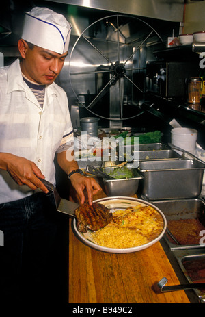 1, one, Mexican man, cook, cooking, Mexican restaurant, Mexican food and drink, food and drink, Novato, California, - Stock Photo