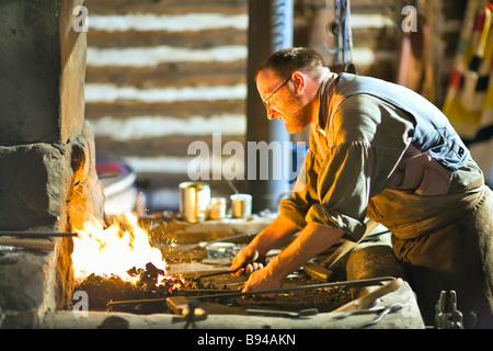 Blacksmith at the Festival du Voyageur, Winnipeg, Manitoba, Canada - Stock Photo