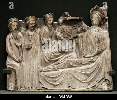 Relief Birth Adoration of the Magi by unknown artist of the British school of the early 15th century at the exhibition - Stock Photo