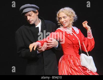Yevgeny Redko as Vissarion Belinsky and Nelli Uvarova as Natalie Beer in the showcase of Tom Stoppard s The Coast - Stock Photo