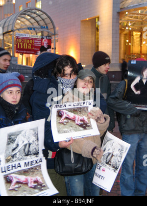 Animal rights activists staging a protest action outside Moscow International House of Music against the ceremony - Stock Photo