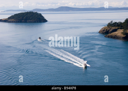 Ocean view of San Juan Islands WA USA with motorboats from Deception Pass Bridge, Washington - Stock Photo