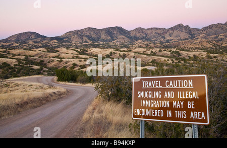 US Mexico travel warning sign - Stock Photo