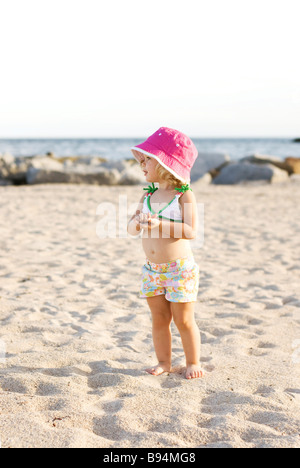 girl in pink hat - Stock Photo