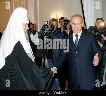 Vladimir Putin president of the Russian Federation meeting the Patriarch of Moscow and All Russia Alexis II in Novo - Stock Photo