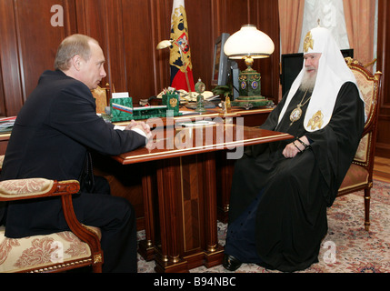 Russian President Vladimir Putin met with Patriarch Alexis II of Moscow and All Russia in the Kremlin - Stock Photo