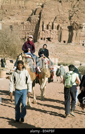 Tourists riding camels along the the Collonaded street, Petra, Jordan, Middle east - Stock Photo