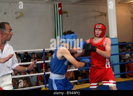 A boxing match at the 3rd Abkhazia School Games hosted by the Republican Children s Boxing Wrestling and Weightlifting - Stock Photo