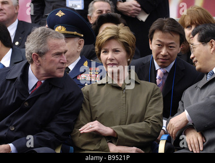 US President George Bush his wife Laura and Chinese President Hu Jintao from left to right in the first row during - Stock Photo