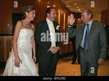 September 8 2007 Russian President Vladimir Putin to the right greeting newlyweds met by chance in the corridor - Stock Photo