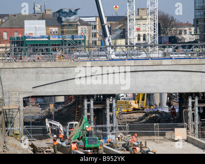 UK. Workers at bridge for new East London Line Tube station for Olympic regeneration in London.Photo © Julio Etchart - Stock Photo