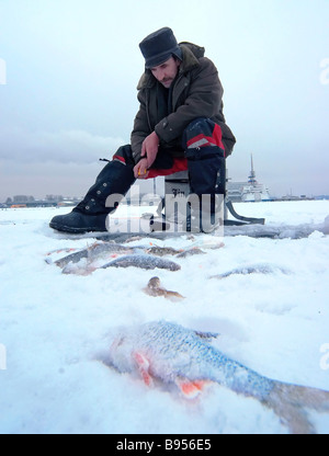 Fishing in the ice bound Gulf of Finland near St Petersburg - Stock Photo