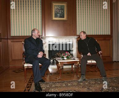 Belarussian President Alexander Lukashenko and Russian President Vladimir Putin left to right at the Bocharov Ruchei - Stock Photo