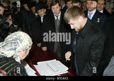 Chechen President Ramzan Kadyrov foreground voting at the polling station of Tsentoroi his clan s village during - Stock Photo