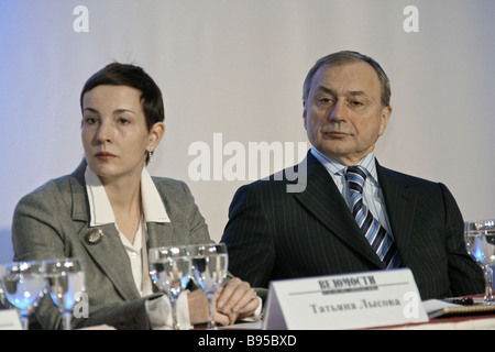 Tatiana Lysova editor in chief of respected business Vedomosti daily and Martin Shakkum chairman of the State Duma - Stock Photo