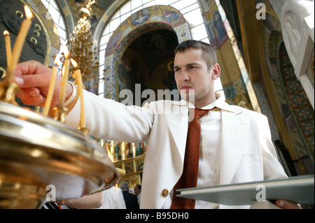 Dmitri Nosov of Russia s Olympic judo team in St George s Church at Poklonnaya Hill during an official gala in which - Stock Photo