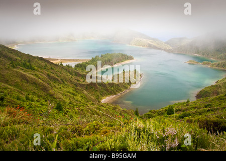 Lagoa do Fogo or Fire Lake at Sao Miguel Azores under low hanging cloud cover - Stock Photo