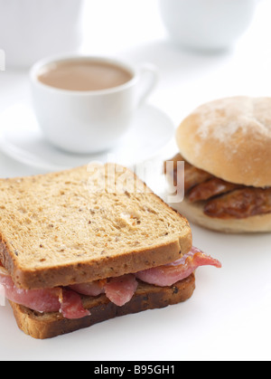 bacon sandwich and sausage bap - Stock Photo