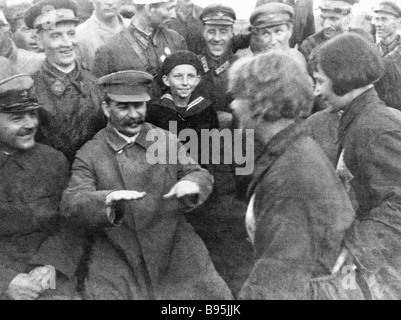 Josef Stalin second left and Kliment Voroshilov left talking with pilots and paratroopers at Tushino airfield - Stock Photo