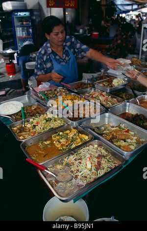 THAILAND South Bangkok Woman selling cooked food from a stall in an alley beside Patpong 1 - Stock Photo