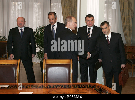 Russian President Vladimir Putin foreground with Mikhail Fradkov Foreign Intelligence Service Director Foreign Minister - Stock Photo
