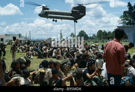 Vietnam War Central Highlands Siege of Kontum Montagnard refugees and United States helicopter evacuation - Stock Photo
