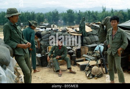 Vietnam War Central Highlands Siege of Kontum Montagnard soldiers gathered in base within a barbed wire perimeter - Stock Photo