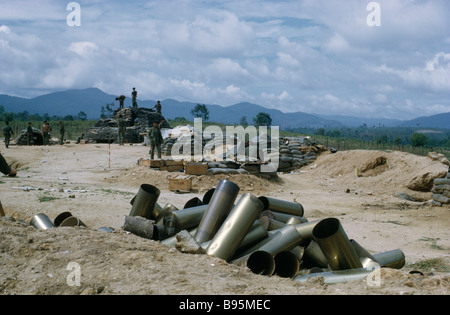 Vietnam War Central Highlands Siege of Kontum Montagnard soldiers in base camp with empty shells from heavy artillery - Stock Photo