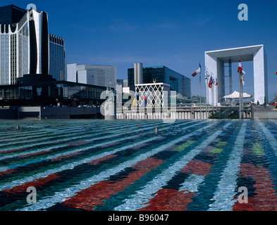 France, Ile de France, Paris, La Defense. La Grande Arche with water pool with colourful, abstract design on floor - Stock Photo