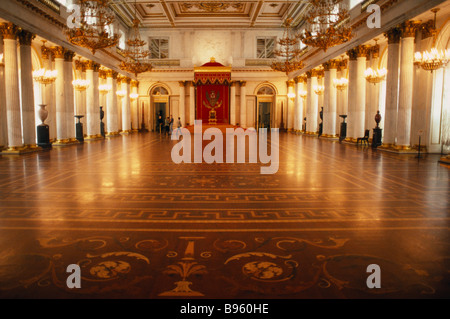 RUSSIA St. Petersburg Winter Palace of the Hermitage Hall of Saint George Interior lined with columns and gold candelabra - Stock Photo