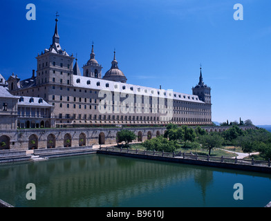 SPAIN Madrid State El Escorial Palace of San Lorenzo de El Escorial seen from the west side with large water pool - Stock Photo