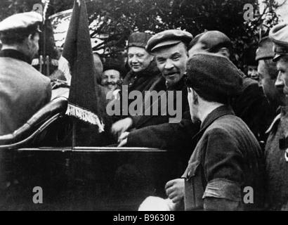 Vladimir Lenin right in the car and Nadezhda Krupskaya left in the car in the Red square - Stock Photo