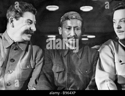 Josef Stalin left Kliment Voroshilov right and a delegate from Tajikistan center at the 2nd congress of collective - Stock Photo