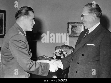 Josip Broz Tito President of Yugoslavia right greets Soviet cosmonaut Andriyan Nikolayev - Stock Photo
