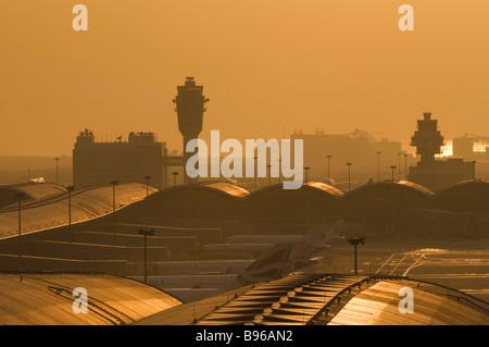 Smog shrouds Hong Kong Chek Lap Kok Airport at sunset. - Stock Photo