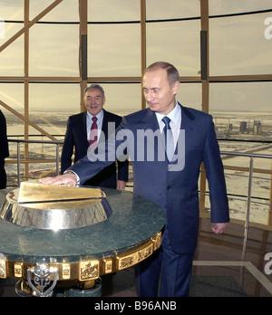 Russian President Vladimir Putin accompanied by Kazakh President Nursultan Nazarbayev admires monument Astana Baiterik - Stock Photo