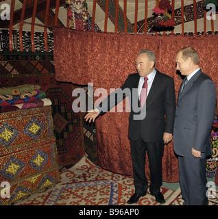Russian President Vladimir Putin accompanied by Kazakh President Nursultan Nazarbayev at Astana based Presidential - Stock Photo