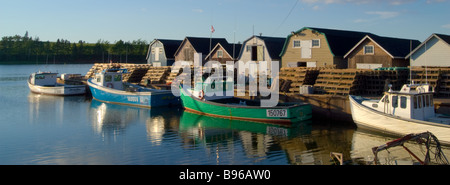 Panorama Boats in harbor with lobster traps stacked New London Prince Edward Island Canada - Stock Photo