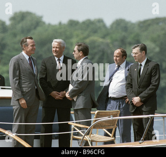 Russian President Boris Yeltsin second from left and U S President George Bush first from left during a trip to - Stock Photo