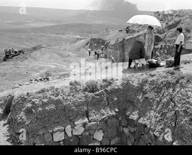 Archaeologists doing excavation work in the ancient Erebuni Fortress on the outskirts of Yerevan Armenia - Stock Photo